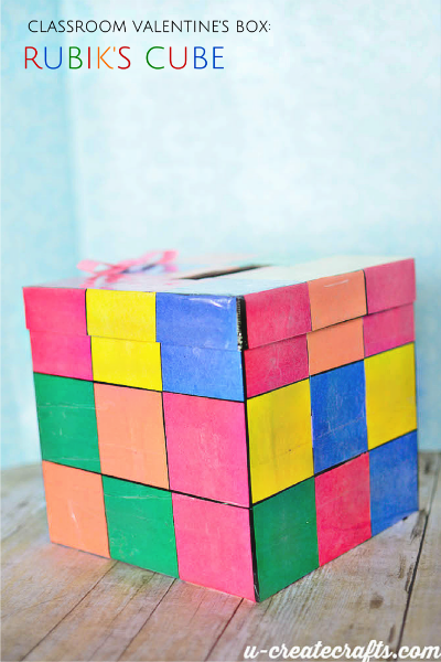 my 7 year old daughter izzy had the most perfect idea for a classroom valentine box make a rubiks cube version after telling her aunt kari all about it